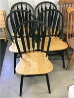 Five dark green wooden kitchen chairs, some wear