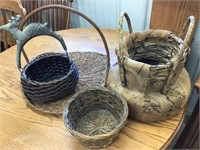 Group of baskets, one with metal Deer handle