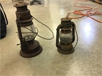 Two barn lanterns, rusted