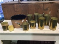 Painted crock, candles and brass tubes
