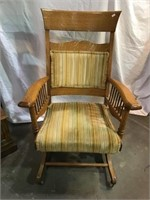 Upholstered chair with front casters