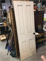 Four panel wooden door, 26 x 73 3/4