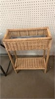 Brown wicker planter stand