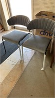 2 grey chairs