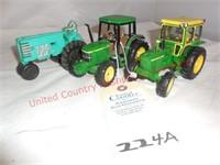 (2) Mini J.D. Tractors 1 auburn rubber tractor
