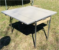 "Daystrom Table w/ pullout sides, 40"" x 25""."