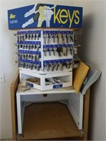 Key grinder,  keys and a rolling shelf