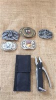 Brian Greise plaque, belt buckles and a plier