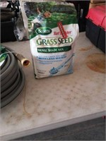 100ft garden hose and grass seed.