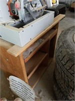 Rigid radial arm saw with cabinet.