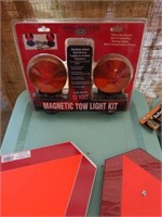 Emergency reflective triangles, magnetic tow