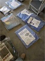 8 miscellaneous sized tarps