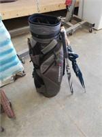 New Adamsgolf golf bag and a used wheeled caddy.