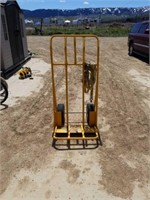 Heavy duty dolly with strap.