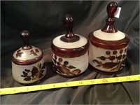 Three red glass cut to clear covered dishes