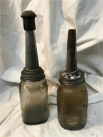 Two oil cans