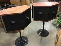 Bose speakers on pedestals