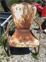 Metal lawn chair, rusted