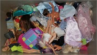 Bin of Barbie Dolls