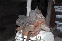 pair of western saddles, tack & saddle rack