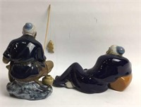 Pair of Ceramic Mud Men