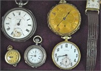 (14) VINTAGE WATCHES AND A CARTIER TRAVEL CLOCK