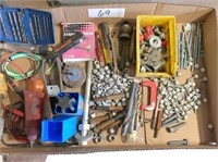 box of screws, bolts, drill bits, large tap, pipe