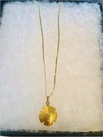 14K Sandollar pendant & 16 in chain weighs 3.6 gr