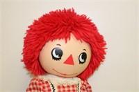 2 plastic Raggedy Ann dolls