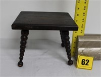 small wooden stool with ball legs