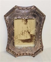 ornate metal picture frame, stone box, baby items