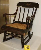 Wooden child's rocker w/rush seat