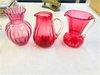 3 pieces of Cranberry art glass 2 pitchers & vase