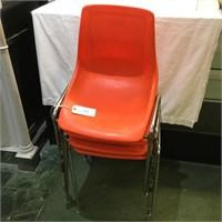 4 Orange Hard Plastic Chairs