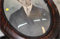 ANTIQUE PHOTO IN CURVED GLASS FRAME