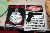 2 METAL GUN SIGNS