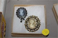 2 BROOCHES