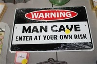 METAL MAN CAVE SIGN
