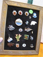 Framed Lot of Souvenir & other Charms, Brooches