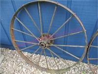 (2) Antique iron wheels (38in diameter) matching