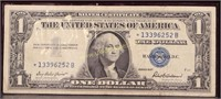 1957 STAR NOTE BLUE SEAL ONE DOLLAR SILVER CERT.