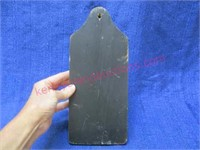 Iron match holder on wooden board (reprod)