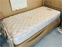 Twin size bed with Caress Mattress