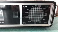 Vintage Clock Radios and GE Portable Radio