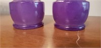 Pair of two heavy purple glass candle holders