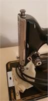 Vintage black singer sewing machine with cabinet