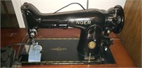 Vintage Singer sewing machine in wooden cabinet