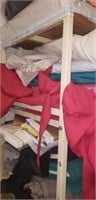 Estate lot of fabric and a metal shelf