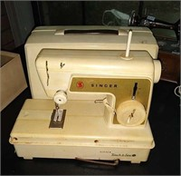 Vintage sewing machine with box