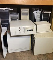 Various Desktop Computers in Stages of Repair